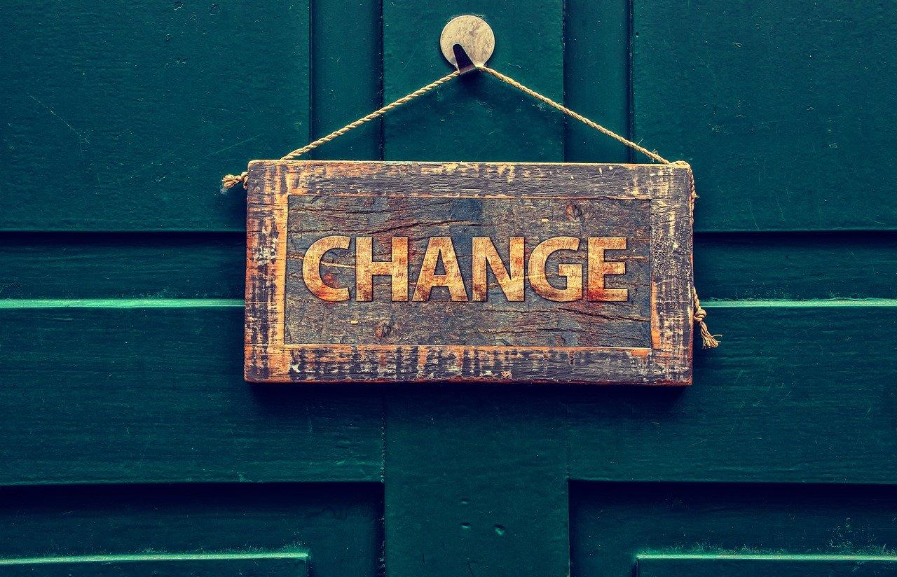 change sign hanging on blue background