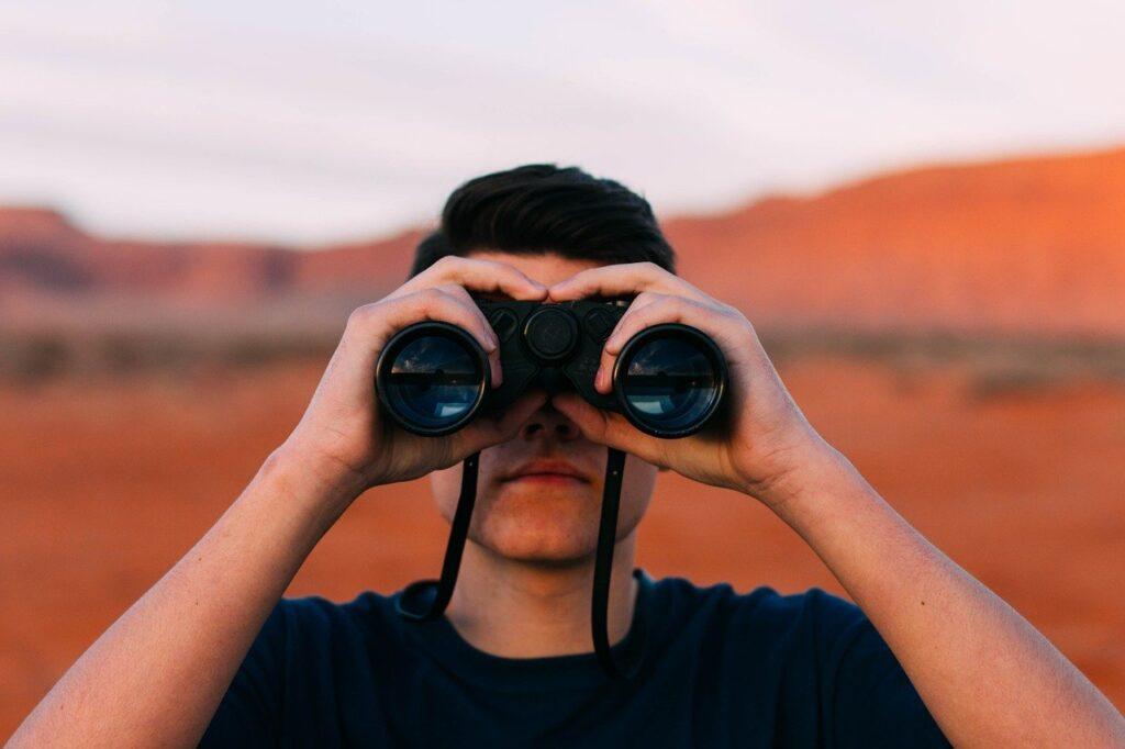 Close-up of man with binoculars