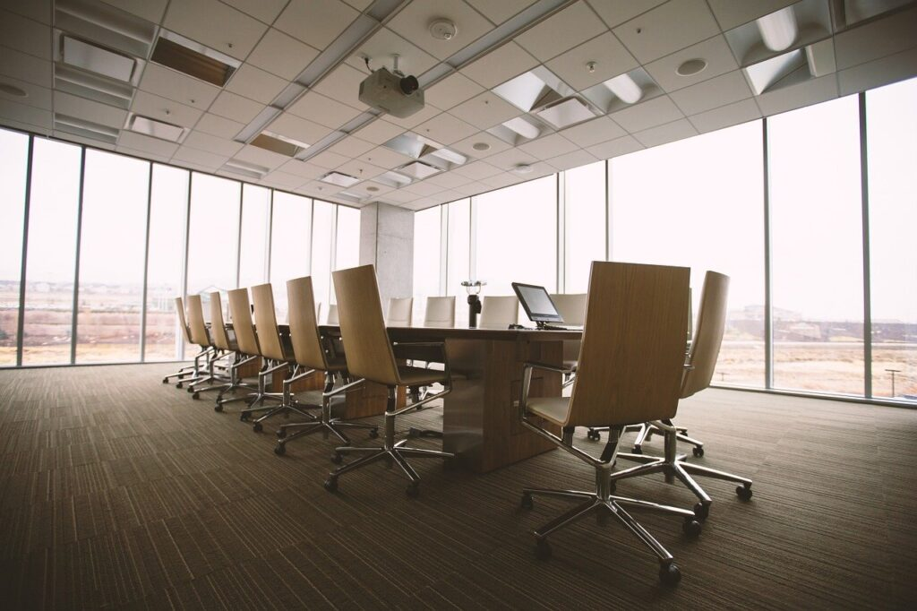 empty conference room or office space with table and chairs