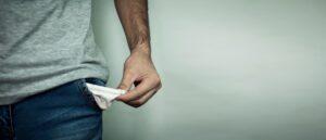 no money man showing empty pockets